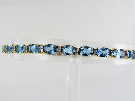Other 14kt Yellow Gold Diamond and Blue Topaz Bangle Image 5