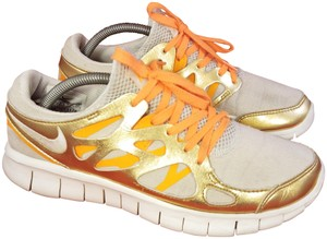 Nike gold and beige Athletic