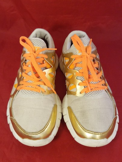 Nike gold and beige Athletic Image 1