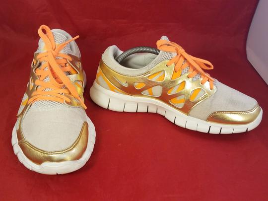 Nike gold and beige Athletic Image 2