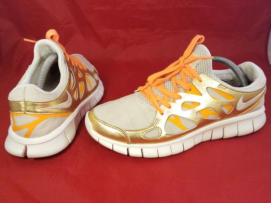 Nike gold and beige Athletic Image 3