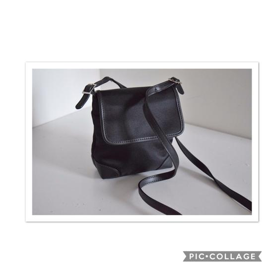 Preload https://img-static.tradesy.com/item/22878334/etienne-aigner-black-canvas-and-leather-cross-body-bag-0-0-540-540.jpg