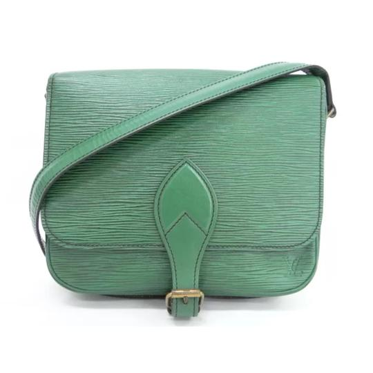 Preload https://img-static.tradesy.com/item/22879006/louis-vuitton-cartouchiere-mm-small-shoulder-green-leather-cross-body-bag-0-0-540-540.jpg