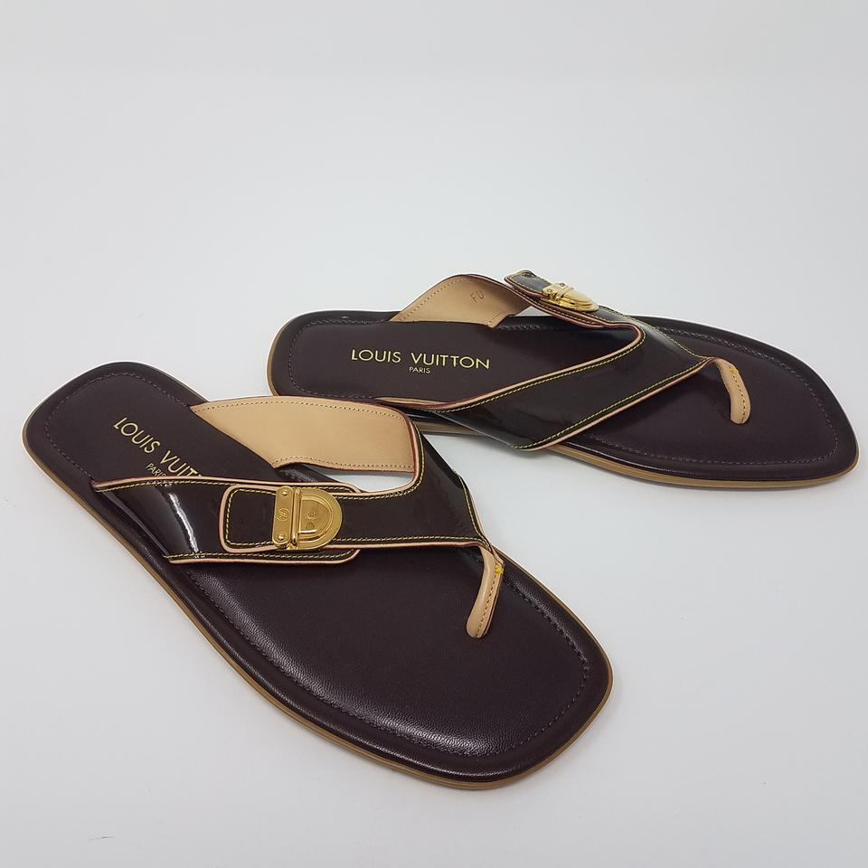 935d5aa6edef Louis Vuitton Brown Gold Chocolate Patent Leather Lv Logo Sandals. Size  EU  ...