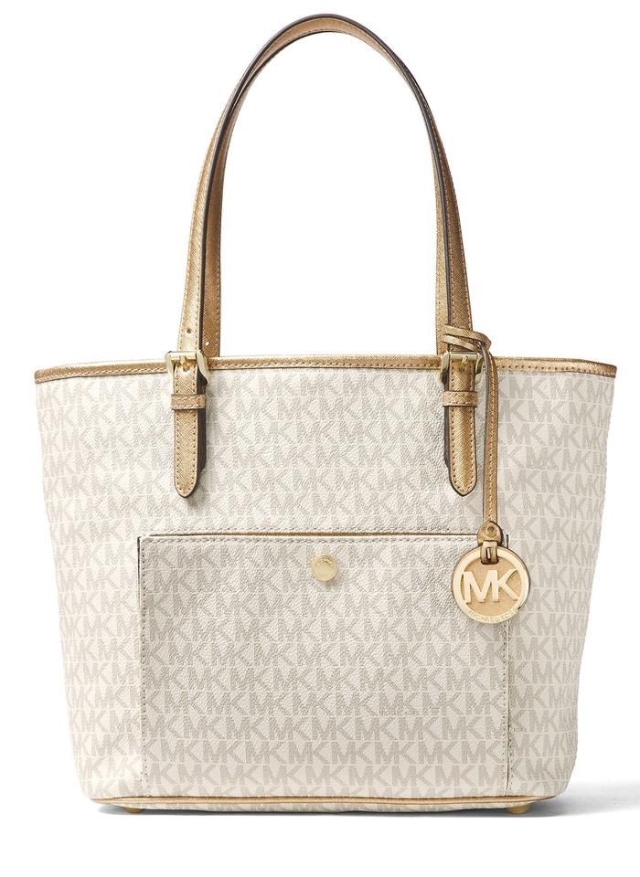 5a5950cff271 Michael Kors Logo Signature Jet Set Item Medium Top Zip Snap Pocket Tote in  Vanilla ...
