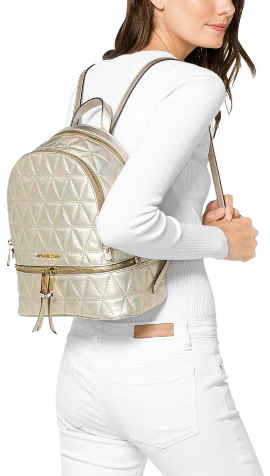 88d677db17 Michael Kors Rhea Medium Metallic Quilted-leather Pale Gold Leather Backpack