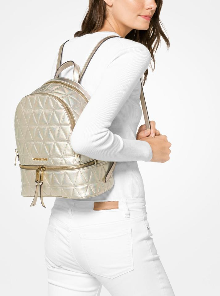 6ac3fc21969d Michael Kors Rhea Medium Metallic Quilted-leather Pale Gold Leather Backpack