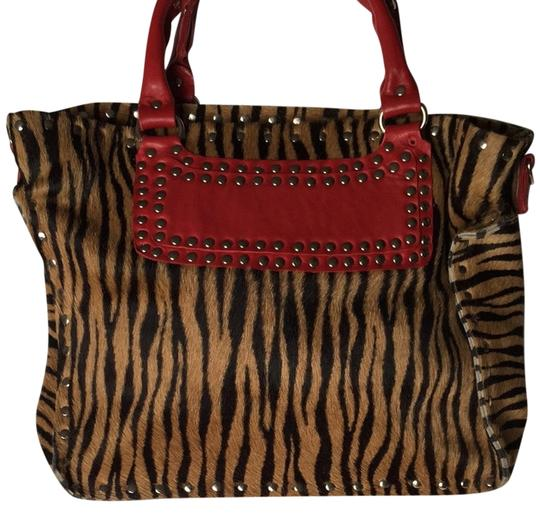 Preload https://item2.tradesy.com/images/tiger-pony-hair-tote-2289491-0-0.jpg?width=440&height=440