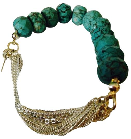 Preload https://item1.tradesy.com/images/kenneth-cole-bluesilver-nwot-faceted-turquoise-stone-and-multi-strand-silver-tone-chain-stretch-brac-2289550-0-0.jpg?width=440&height=440