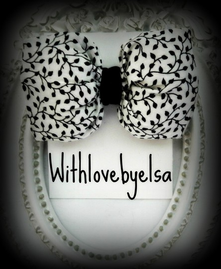Other Stuffed hair bow made in printed fabric finished with black velvet ribbon.