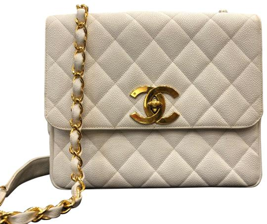 Preload https://img-static.tradesy.com/item/22900528/chanel-classic-flap-vintage-square-caviar-quilted-handbag-gold-hardware-white-leather-cross-body-bag-0-1-540-540.jpg