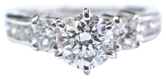 Preload https://img-static.tradesy.com/item/22902402/e-fine-round-diamond-solitaire-w-channel-set-accents-engagement-12-ring-0-1-540-540.jpg