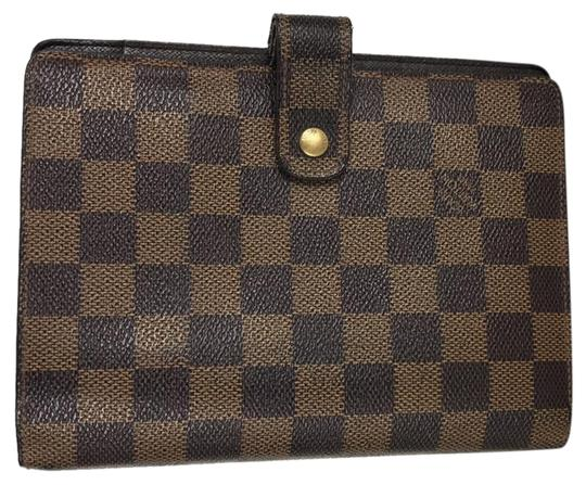 Preload https://img-static.tradesy.com/item/22902700/louis-vuitton-agenda-mm-damier-ebene-diary-cover-10839-brown-canvas-clutch-0-1-540-540.jpg