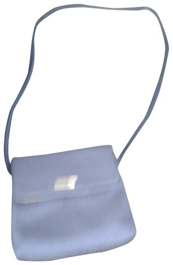 Preload https://img-static.tradesy.com/item/22905006/evan-picone-in-silver-metal-front-of-light-blue-all-man-made-materials-cross-body-bag-0-1-540-540.jpg