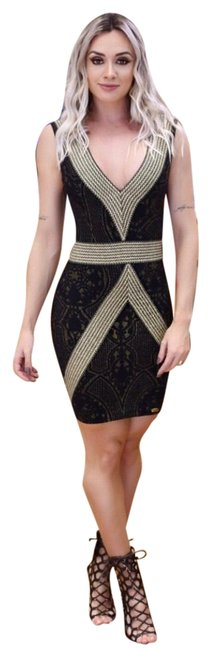 Preload https://img-static.tradesy.com/item/22905657/black-and-gold-short-night-out-dress-size-8-m-0-1-650-650.jpg