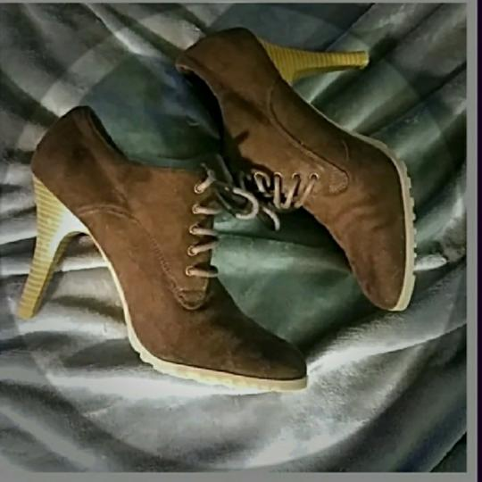 Preload https://img-static.tradesy.com/item/22906097/american-eagle-outfitters-brown-ae-stiletto-style-bootsbooties-size-us-8-regular-m-b-0-2-540-540.jpg