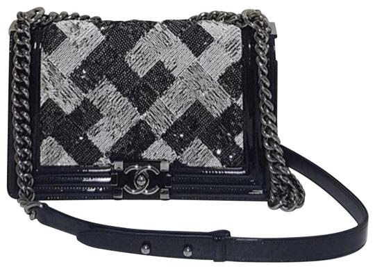 Preload https://img-static.tradesy.com/item/22906879/chanel-classic-flap-boy-rare-sequin-black-patent-leather-exterior-trimmed-with-suede-silver-hardware-0-3-540-540.jpg