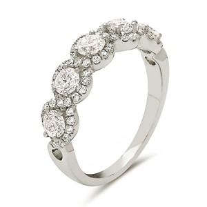 Other 18K white gold 5 stone micro pave round halo style wedding band.