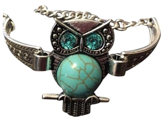 Preload https://img-static.tradesy.com/item/22907473/turquoise-ladies-owl-with-blue-stones-bracelet-0-1-540-540.jpg