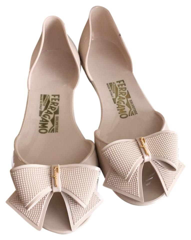 c1d545535 Salvatore Ferragamo Nude Jelly Slip-ons with Signature Gold Accents ...