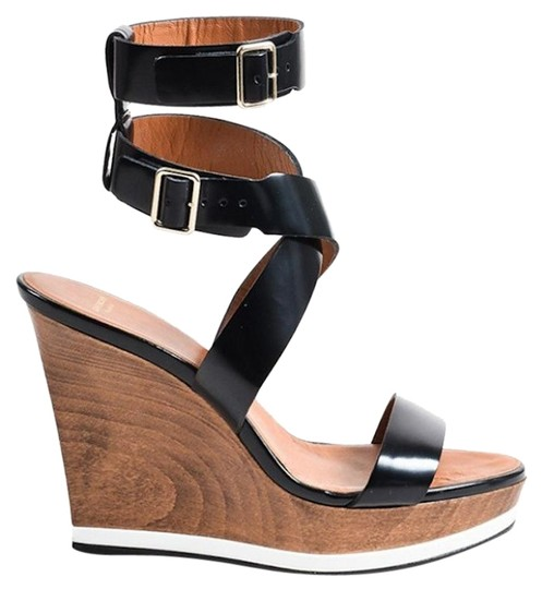 Preload https://img-static.tradesy.com/item/22912990/givenchy-black-leather-wood-patent-leather-wedges-size-eu-36-approx-us-6-regular-m-b-0-2-540-540.jpg
