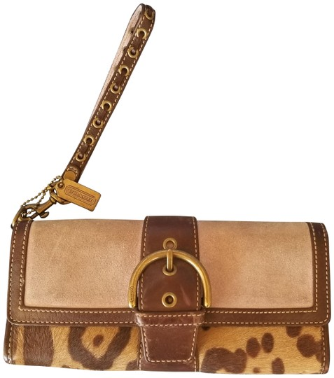 Preload https://item4.tradesy.com/images/coach-ocelot-wallet-lilac-and-brown-leather-wristlet-22913523-0-1.jpg?width=440&height=440