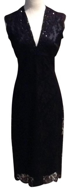 Preload https://item4.tradesy.com/images/black-lace-and-silk-mid-length-cocktail-dress-size-6-s-22913808-0-1.jpg?width=400&height=650