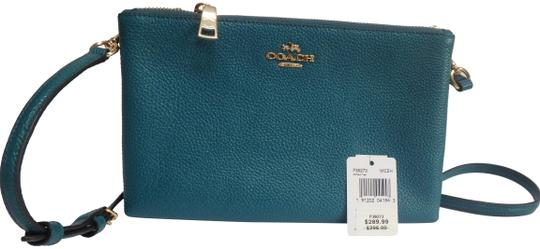 Preload https://item2.tradesy.com/images/coach-f38273-dark-teal-pebbled-leather-cross-body-bag-22913811-0-1.jpg?width=440&height=440