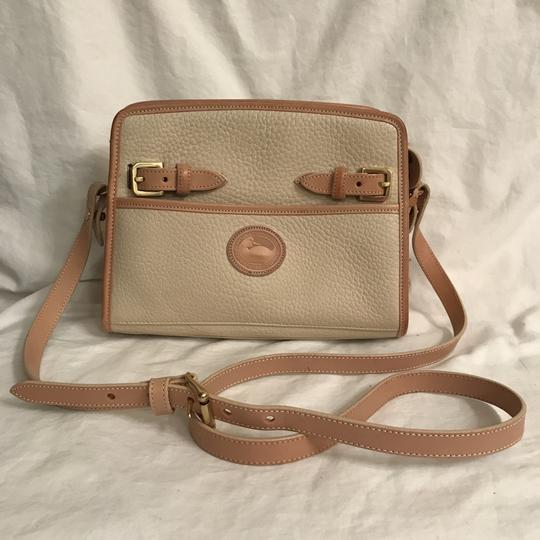 Preload https://item5.tradesy.com/images/dooney-and-bourke-rare-color-vintage-beige-tan-all-weather-leather-cross-body-bag-22914369-0-0.jpg?width=440&height=440