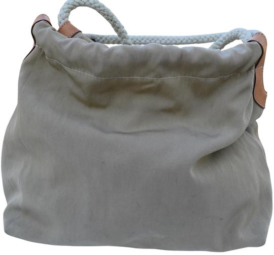 Preload https://img-static.tradesy.com/item/22919301/fossil-75082-beige-and-tan-canvas-leather-hobo-bag-0-1-540-540.jpg