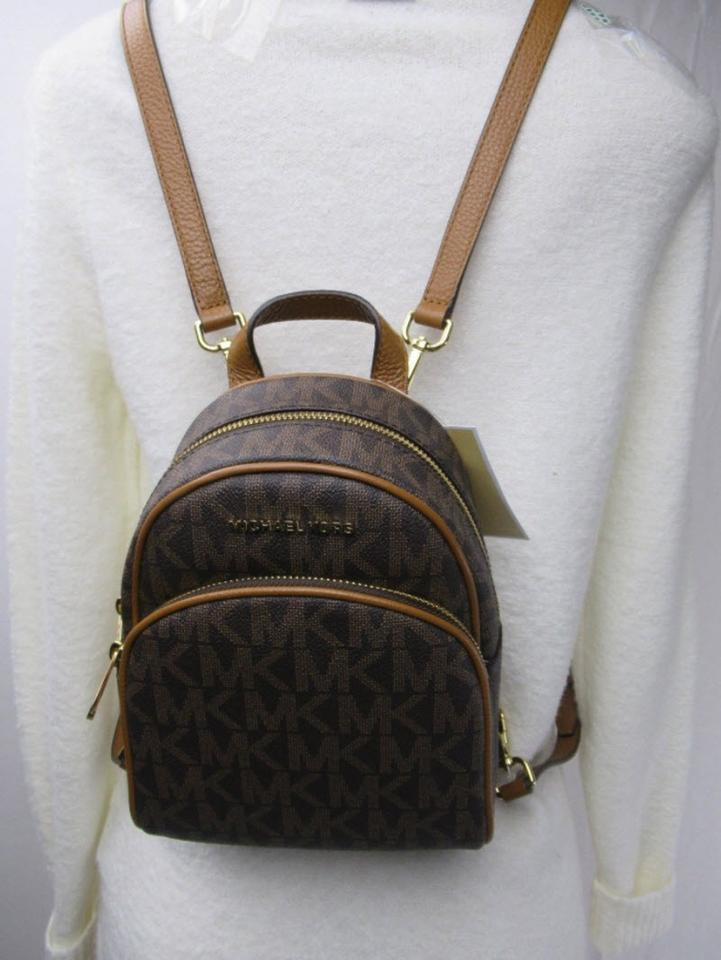 11c751c1b3 Michael Kors Abbey Xs Brown and Acorn Monogram Canvas Backpack - Tradesy