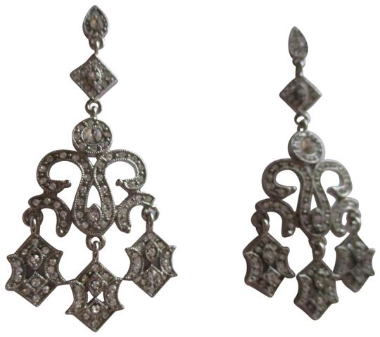 Preload https://img-static.tradesy.com/item/22921395/silver-rhinestone-chandelier-earrings-0-1-540-540.jpg