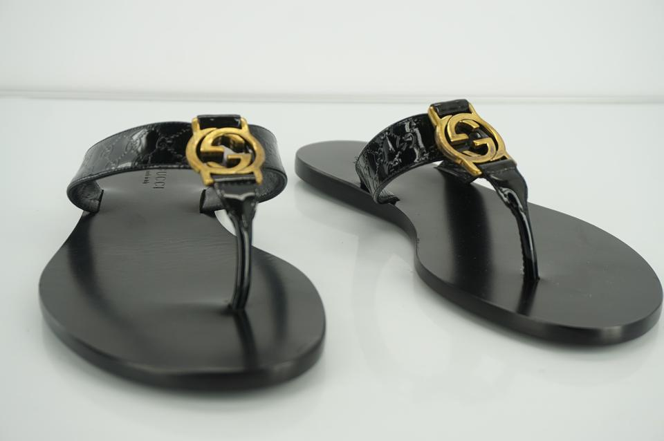 5384cbe6af0aa9 Gucci Black Women s Gg Microguccissima Patent Leather Thong Sandals ...