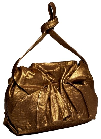 Preload https://item1.tradesy.com/images/carlos-falchi-gold-leather-cross-body-bag-2293390-0-0.jpg?width=440&height=440