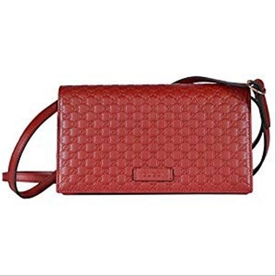 Preload https://img-static.tradesy.com/item/22935830/gucci-gg-guccissima-leather-on-strap-red-cross-body-bag-0-2-540-540.jpg