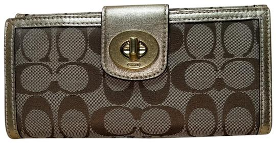 Preload https://img-static.tradesy.com/item/22936330/coach-monogram-wallet-brown-and-gold-canvas-leather-wristlet-0-2-540-540.jpg