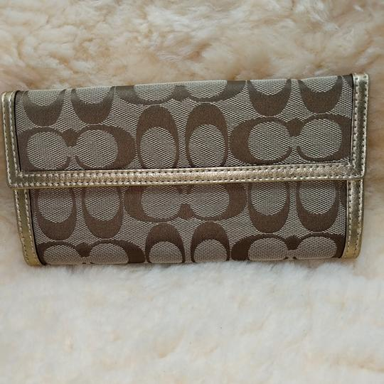 Coach Wristlet in Brown and gold Image 1