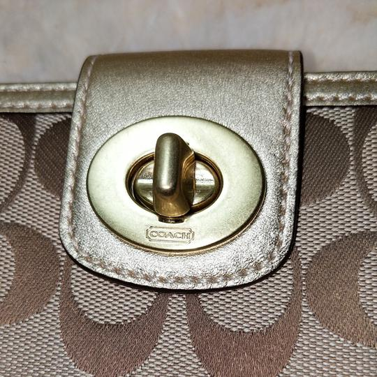 Coach Wristlet in Brown and gold Image 2
