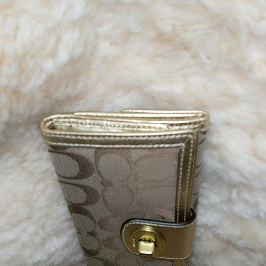 Coach Wristlet in Brown and gold Image 3