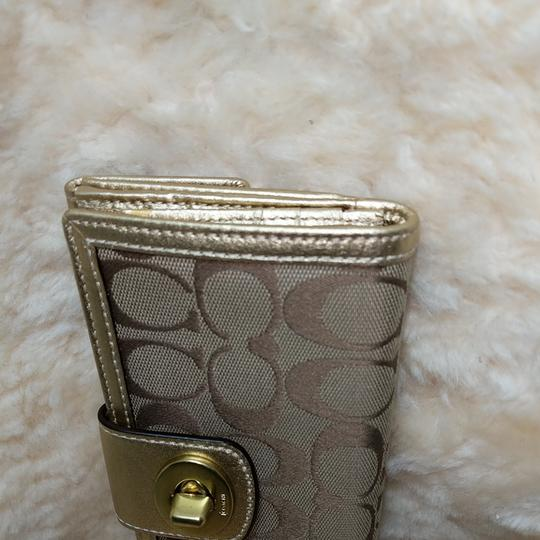 Coach Wristlet in Brown and gold Image 4