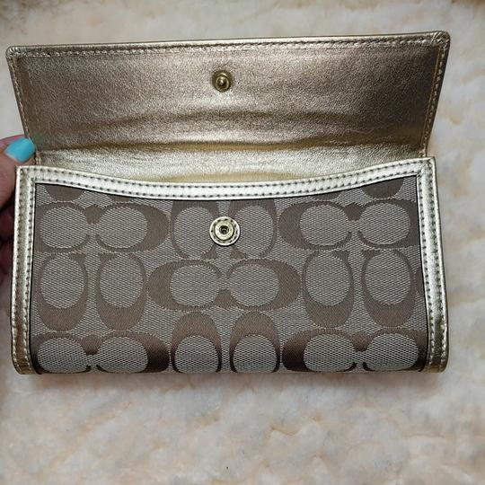 Coach Wristlet in Brown and gold Image 6