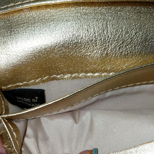 Coach Wristlet in Brown and gold Image 8