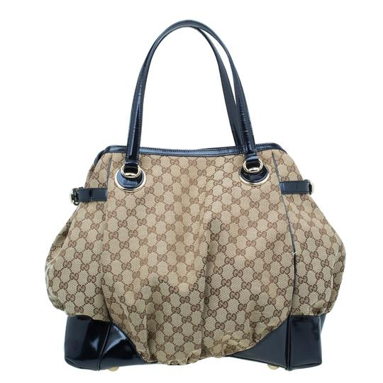 Preload https://img-static.tradesy.com/item/22937297/gucci-bag-black-gg-canvaspatent-leather-large-full-moon-beige-canvas-tote-0-0-540-540.jpg