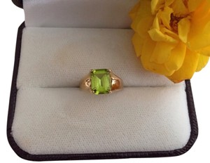 14k Gold Emerald Cut Peridot Ring.