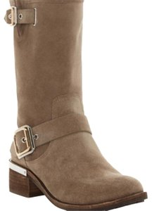 Vince Camuto color is called foxy, it is a beige/taupe. Boots