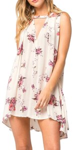 Free People short dress Ivory Sleeveless Floral Print Flowy on Tradesy