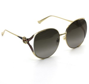 Gucci Gucci 0225S Round Sunglasses Gold Frame with Brown Gradient Lenses