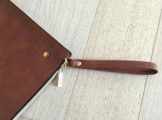 Urban Outfitters crown Clutch