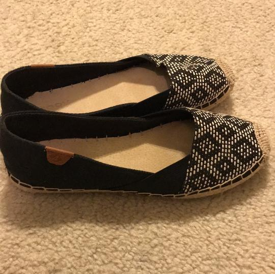 Sperry black and nude Flats