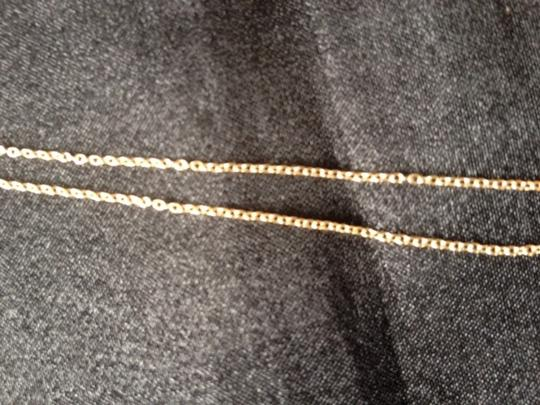 Local Japanese store that imports Japanese clothes and jewelry Gold drift wood like pendent necklace